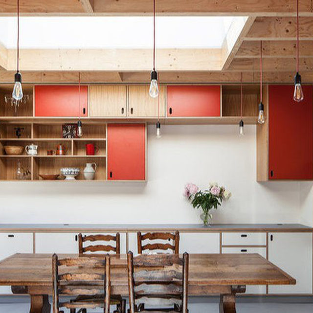 Want to incorporate red (or another bold color) in your kitchen design? Color blocking can balance it out for that pop of color you're looking for without overwhelming the rest of the space. (📷:@cba.ltd) Head to our link in bio for more ways to design with red kitchen cabinets.