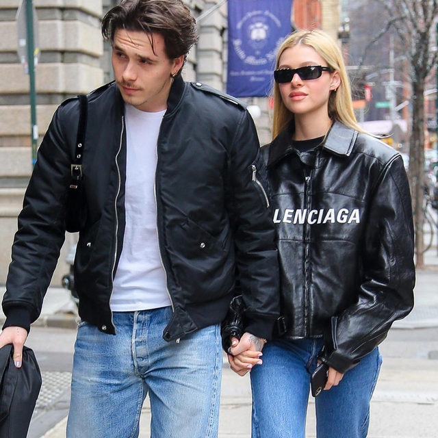 Wait - are @NicolaAnnePeltz and @BrooklynBeckham channelling Posh and Becks' 1990s/2000s couple style? From in-sync blue jeans and white tees to matching cocktail looks and coordinated casualwear, the future Beckhams 2.0 are paying homage to Victoria and David Beckham's peerless style. Read the text and see the full selection of images by @JuliaHobbs_ at the link in bio.