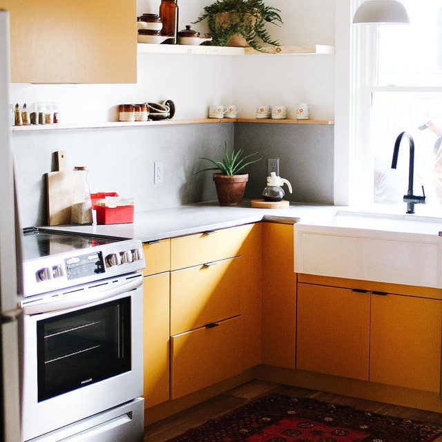 Balance out bright, warm cabinets with gray countertops for a beautiful kitchen combo. (submitted by @thechrisandclaudeco)