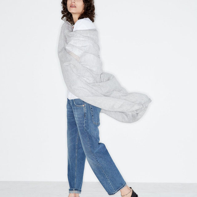 Layers. #Raey superfine cashmere scarf, recycled-yarn T-shirt and baggy boyfriend jeans. Shop now at @MATCHESFASHION #MATCHESFASHION.