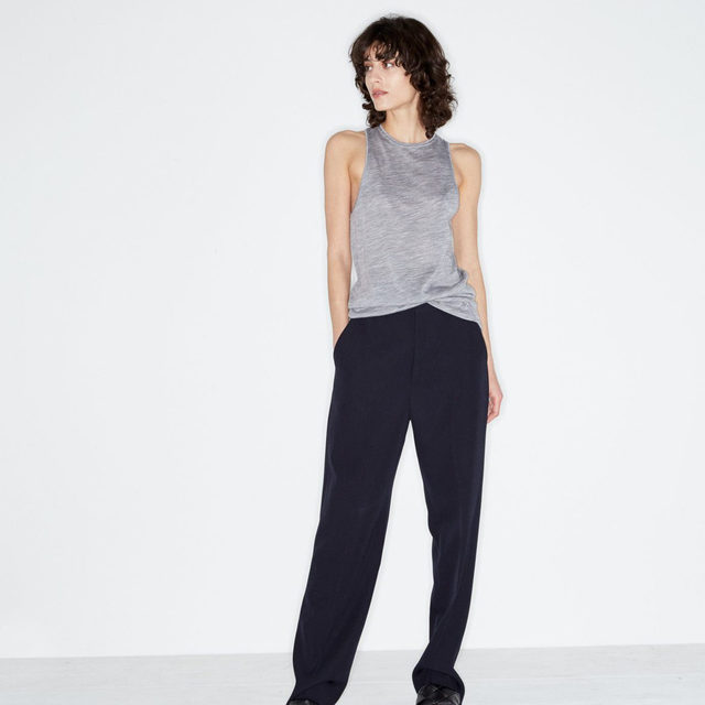Day to evening. #Raey wool tailored trousers and racer-back tank top. Available at @MATCHESFASHION #MATCHESFASHION.