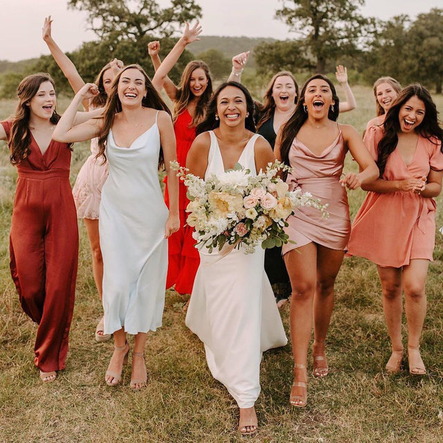 There's no denying the happiness in this photo. 🥰 Head to the #linkinbio for 32 sweet little gift ideas to send your best friends/support system right now! 📸: @phiiliipwinhamphoto 👗: @sarahseven from @lovelybride