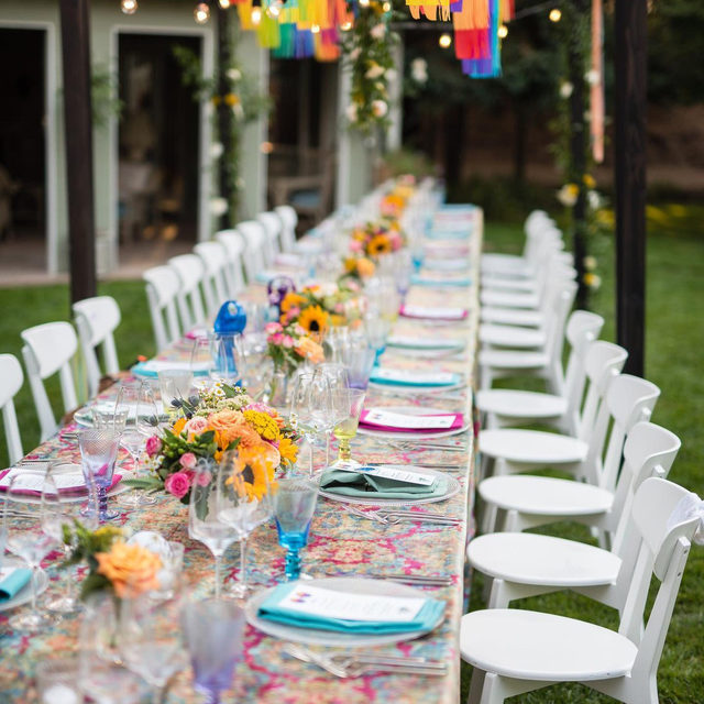 A 'Summer of Love' themed b-day bash from @roqueevents and @maeflowerssonoma with our #enchantresslinen in Mulberry 💖💙💚💛🧡 So fun! Photography @tephotocinema   #latavolalinen #transformyourtable #birthdayparty #birthdaybash #dinnerparty #livecolorfully #brightcolors #napa #napavalley #sonoma #winecountry #bdayparty #partydecor #tablescape #sunflowers