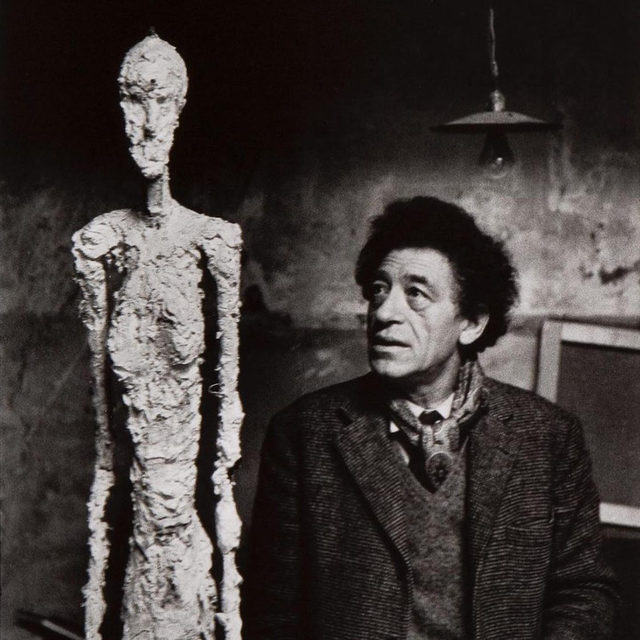 """Work by Alberto Giacometti is on view in """"L'homme qui marche: Une icône de l'art du XXè siècle"""" at Institut Giacometti, Paris, through November 29.  This exhibition, whose title translates to """"The Walking Man: An Icon of 20th Century Art,"""" explores Giacometti's most famous work, the """"Walking Man."""" The show brings together for the first time the various life-size models, as well as most of the sculpted and drawn variations, of the famous artwork. Accompanied by numerous unpublished documents and drawings, it traces the genealogy of the motif, from the """"Walking Woman"""" of Giacometti's Surrealist period to the icons created between 1959 and 1960. Learn more via the link in our bio. __________ #AlbertoGiacometti @fondation_giacometti (1) Alberto Giacometti and a """"Walking Man,"""" 1960. Photo: René Burri, Archives de la Fondation Giacometti, Paris; (2, 3) Installation views, """"L'homme qui marche: Une icône de l'art du XXè siècle,"""" Institut Giacometti, Paris, July 4–November 29, 2020 © Succession Alberto Giacometti"""