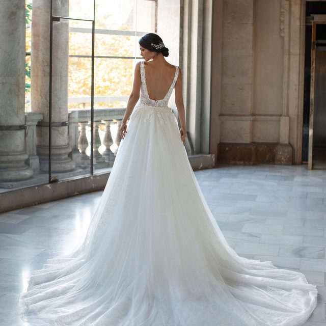 Stunning rich brocade and the most flattering square shaped back. The Talmadge gown is perfect for accessorizing with a full cathedral train or a delicate embroidered veil. Book your appointment at your nearest Pronovias and discover it. #Pronovias