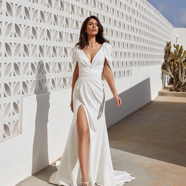 Jaw-dropping drapery in fluid crepe. Book now your appointment at your nearest Pronovias Store to try on the NEW #PronoviasPremiere Collection. Link in bio. Dress: Abby. #Pronovias