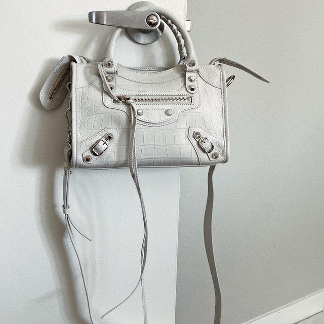 MAKE IT A MINI • the @balenciaga mini city bag - link in bio to shop! #lookFWRD