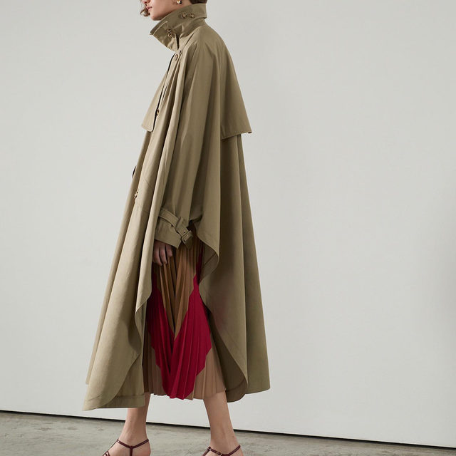 Upgrading your outerwear with @stellamccartney's classic cape trench #brownsfashion #stellamccartney