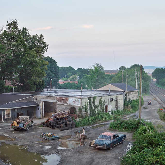 """""""The tension between beauty and sadness is a powerful one. It's something that I strive for."""" ーGregory Crewdson  Happy birthday to Gregory Crewdson, born on this day, September 26, in Brooklyn.   For three decades, Crewdson's photographs of houses, landscapes, and people have become canonical representations of the liminal and forgotten in America. Crewdson orchestrates every detail of his scenes, from casting the landscape's light and color to devising the words on a street sign.   Crewdson's new series, """"An Eclipse of Moths,"""" is titled for the phenomenon of moths' innate navigational system drawn off course, disoriented instead towards artificial lights. In these pictures, Crewdson's figures appear between two places, caught somewhere out of time, isolated and unsettled with a premonition of both perilousness and hope. """"An Eclipse of Moths"""" is now on view at Gagosian, Beverly Hills. Follow the link in our bio to learn more.  ________ #GregoryCrewdson #Gagosian @crewdsonstudio Gregory Crewdson, """"The Taxi Dep"""