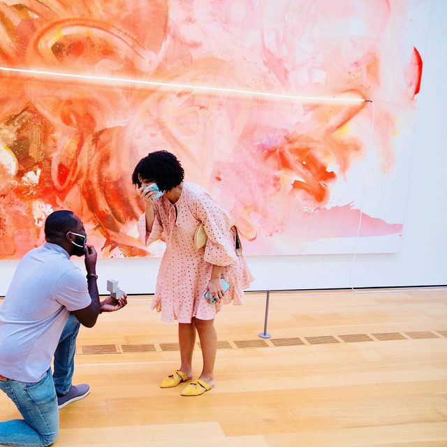 """Congratulations to the couple who recently got engaged in front of Mary Weatherford's """"GLORIA"""" (2018), a museum acquisition at the High Museum of Art, Atlanta! The work was included in """"I've Seen Gray Whales Go By,"""" the artist's first solo exhibition with the gallery at Gagosian, 555 West 24th Street, New York.  An exhibition of new paintings by Weatherford, titled """"Train Yards,"""" is on view at Gagosian, Grosvenor Hill, London, through December 19. Follow the link in our bio to learn more. __________ #MaryWeatherford #Gagosian @maryweatherford @highmuseumofart #Repost: @shaleentibbs. Photos: @hi_stakez"""