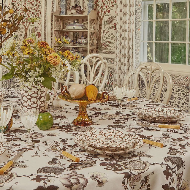 Our new brown sponge ware, which is ideal for fall but actually works any time of year. I love the idea of mixing them with interesting salad plates that add another layer – we designed a set of four with four different flowers and a white linen napkin with matching embroideries. Available via @modaoperandi and ToryBurch.com #perfectlyimperfect #toryburchhome