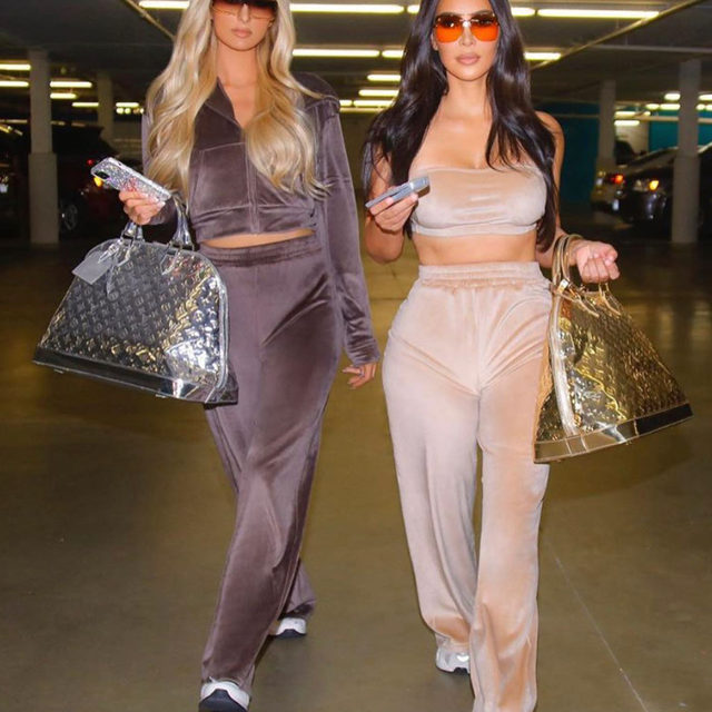Kim K and Paris in velour again had us feeling nostalgic! 🙌 (And who could forget these bags?!) Link in bio for all the best photos—and outfits—from the early days of their friendship. (📸: @skims)