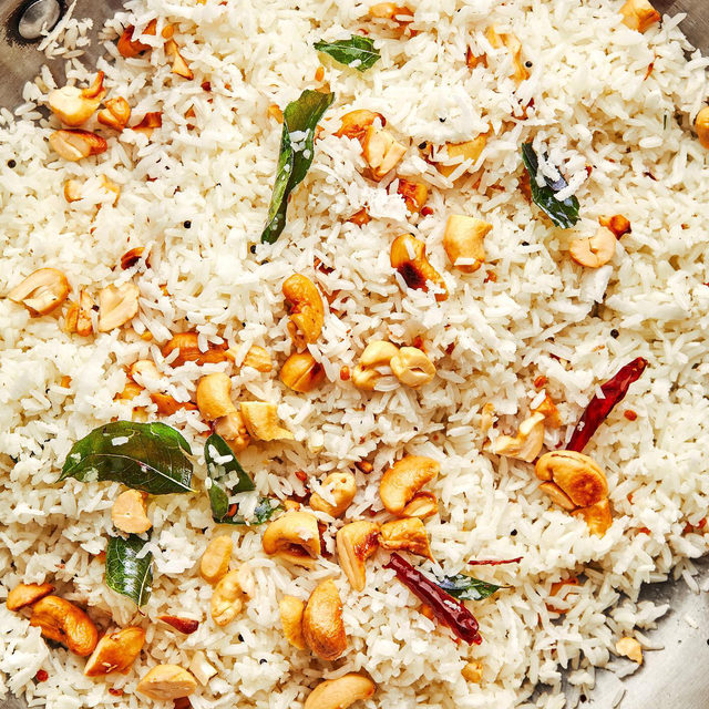 For @brooklyndelhi founder and cookbook author Chitra Agrawal (@chitra), stir-frying leftover rice in ghee with spices, curry leaves, and mix-ins like cashews and fresh coconut takes a simple staple and makes it luxurious. The inspiration for her thuppa anna comes from her mother's home state of Karnataka in South India, where her family has been making this dish for generations. If you're cooking it for dinner, Chitra suggests pairing it with dal and a spicy, tangy achar mixed into the rice. Click the link in our bio for Chitra's thuppa anna recipe. 📷: @laurashoots 🍴: @rebeccajurkevich