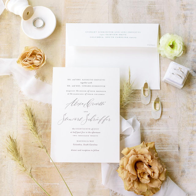 """Simple and oh so sweet! We love the timelessness of this look with muted flower accents 💛  Shop the link in our bio to find the invitation for you. __ Photo: @wesleypetersonphoto via @alexandramadisonweddings  __ """"Elysium"""" Wedding Invitations by #MintedArtist Amy of @designlotus . . . . #weddinginvites #savethedate #weddinginvitation #weddingflatlay #flatlay #invitationdesign #modernwedding #engaged #weddingideas #weddinginspiration #weddingdetails #weddingphotography #weddingplanning #trendybride #weddingstationary #luxurywedding"""