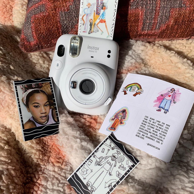 It's super easy to shop on Instagram now that it's launched the Shop tab—check out the 🛍 icon below! To celebrate, we partnered with @Instagram, @fujifilm_instax_northamerica, and Sage Adams (@sageaflocka) to create a limited edition Instax Mini 11 camera that features a sticker sheet of her artwork — and it's available exclusively at UO on Instagram. Tap the tag to buy it now!