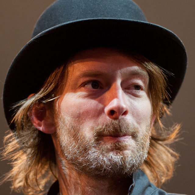 """""""For sale: one bowler hat."""" @radiohead is auctioning @thomyorke's King of Limbs–era bowler to raise awareness of testicular cancer. Find out more at the link in our bio.   📷 by Nick Pickles / Getty Images   #Radiohead #ThomYorke"""