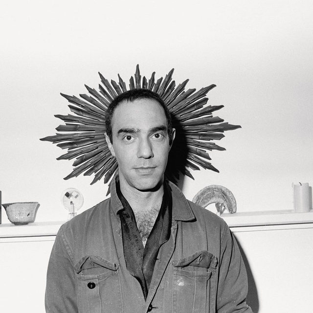 """#GagosianQuarterly: """"It's precisely that lack of conventional good taste that keeps Derek Jarman's art relevant; the fact that it's difficult to pick apart what's inexcusably sentimental from what's righteously abrasive keeps you interested."""" —Mark Hudson  In a piece for """"Gagosian Quarterly,"""" Mark Hudson considers Derek Jarman's enduring legacy and complex relationship to British culture. Follow the link in our bio to read the article. __________ #DerekJarman #Gagosian (1) Derek Jarman, 1981. Photo: Janette Beckman/Getty Images; (2) Derek Jarman in the garden at Prospect Cottage, Dungeness, England. Photo: Geraint Lewis/Alamy Stock Photo"""