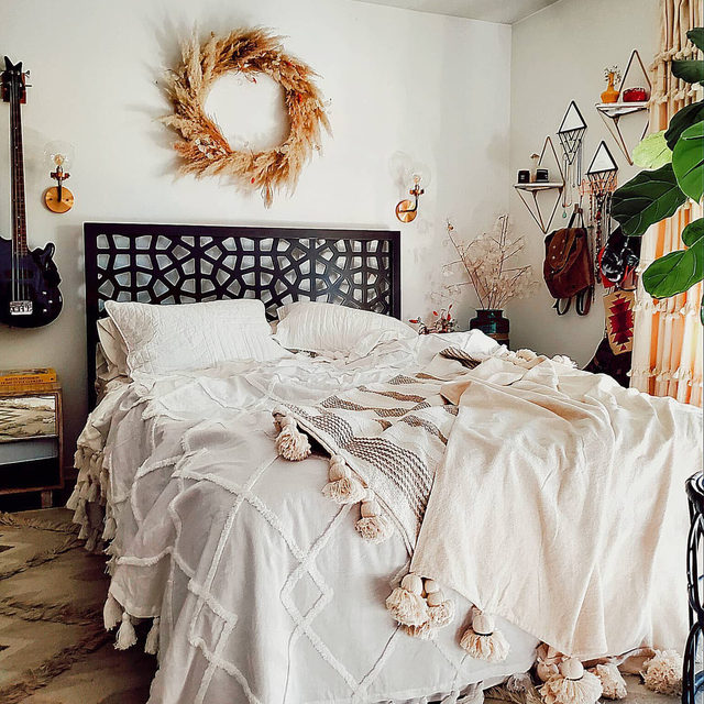 Make your bed the star of your bedroom with a statement headboard. We also love the idea of a seasonal wreath as above-the-bed decor! (📷 submitted by @mypdxhome)