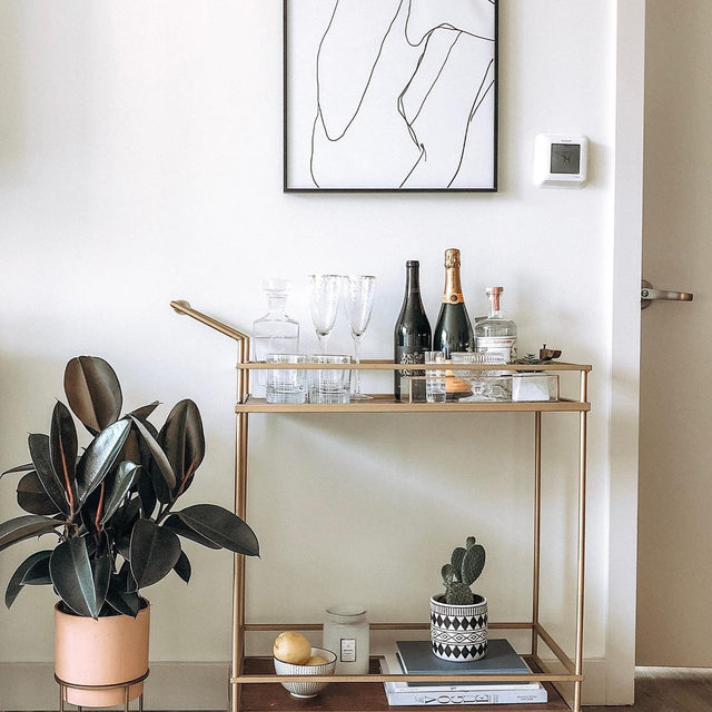Elevate your bar cart area with some wall art. (📷 submitted by @melcstyle)