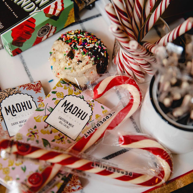 Tis the season to give gifts, listen to holiday music, eat copious amounts of sweets, drink really good wine, sit by a warm fire, look at sparkling lights, burn fraiser fir candles down to their wicks, wear those really cozy socks with the stickies on the bottom…..wait sorry what were we talking about again? Oh right—get your gifts delivered!