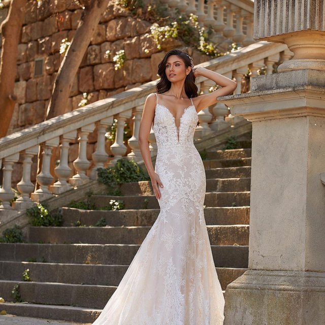 A classic mermaid cut receives an ultra-feminine transformation in luxurious Chantilly lace. With a deep V neck, shoulder-baring spaghetti straps, and a fluid skirt that gently extends from the upper thigh. Dress: Lila. Book your appointment at your nearest #Pronovias to try it on.