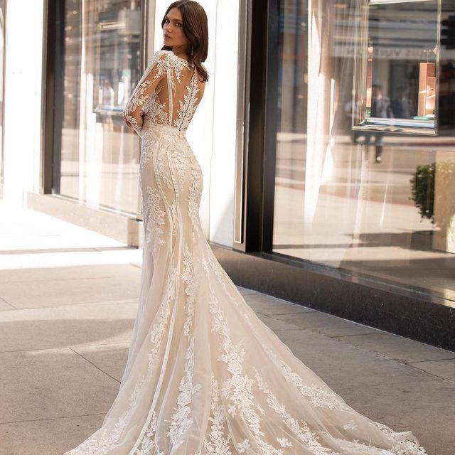 Crafted from intricately embroidered lace and body-contouring beaded rays. Tag a friend who is looking for a long sleeved dress like the Andrews. #Pronovias #AshleyGrahamXPronovias  @pronovias
