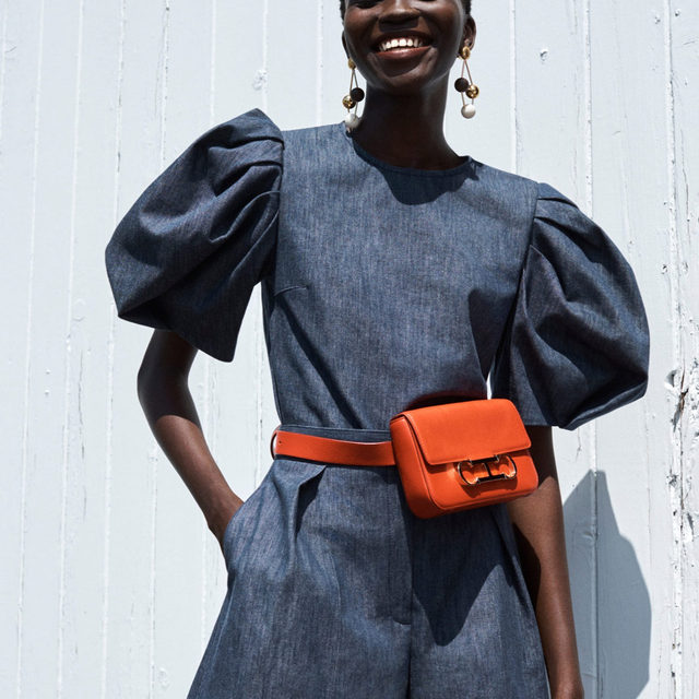 Double denim has never looked so sophisticated. These wide leg shorts and puff sleeve top are tailored in yarn-dyed, stretch-denim and styled with a pop of orange. From the lookbook for our Resort 2021 collection by @wesgordon, featuring @Achenrin captured by @Josholins. #CHInitialsInsignia #CHInsignia  Click to shop the collection now on www.carolinaherrera.com