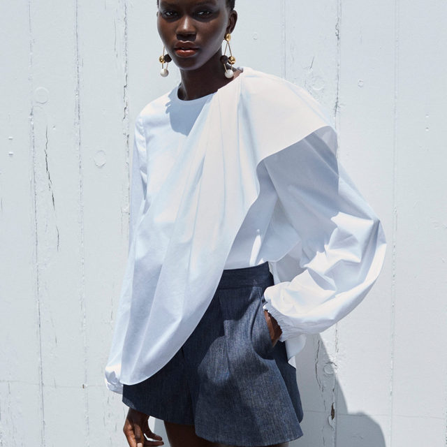 For Resort 2021, creative director @wesgordon reinvents Carolina Herrera's signature white shirt with this elegant blouse, cut from stretch cotton with a draped bodice and full sleeves. From our Resort 2021 lookbook, featuring @Achenrin captured by @Josholins.  Click to shop the collection now on www.carolinaherrera.com
