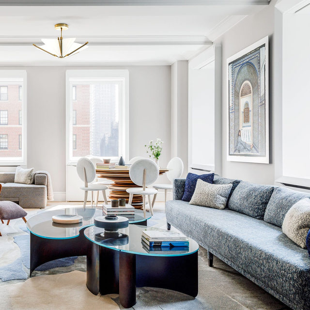"""""""Over time, we've become more interested in taking some design risks,"""" says the owner of this Manhattan family apartment, which appears on the cover of ELLE Decor's January/February issue. Upon moving into their 4,000-square-foot, four-bedroom apartment in Manhattan's Carnegie Hill neighborhood, the family tapped architect Michael K. Chen (@mkcarchitecture) to carry out the renovations. With his sharp spatial ingenuity and love of bold colors, he was the perfect match for the couple, who were looking for a challenge.   In the living room, a @kgblnyc sofa and @vladimirkagandesign chaise are both in fabrics by @hollandandsherryinteriors. The custom cocktail table is by @kinandcompany, the games table and chairs are by @christopherkurtzstudio, the pendant is by @bec_brittain, and the photograph is by @lallaessaydi. Click the link in bio for the full tour. Written by @langealexandra, photography by @maxb.photo."""