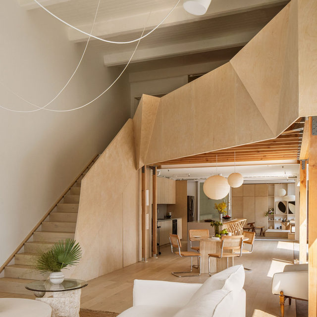 In a former Nabisco biscuit factory in downtown Los Angeles, architect @amandagnwn of @owiudesign bakes sculptural simplicity into a Beaux Arts-era industrial mold. Gunawan stripped it down into an understated space that embraces its factory roots while appealing to her preferred Japanese and Scandinavian aesthetic. Beneath the custom Baltic Birch staircase, built by @inflexionbuilds, and its exposed structural timber is a dining room with a travertine table, vintage Marcel Breuer chairs, and lanterns by Isamu Noguchi. Click the link in bio for the full tour as seen in our Jan/Feb 2021 issue. Written by @vwlawrence, produced by @ingridabram, photography by @thismintymoment.