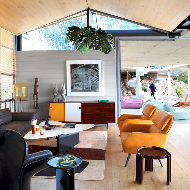 """""""We asked ourselves, 'What would the natural progression of a Palm Springs bungalow be today?'"""" says architect Silvio Rech (@silviorechlesleycarstens) of his newly redesigned home, as seen in our Jan/Feb issue. The Johannesburg house he shares with his wife and partner, architect Lesley Carstens, has sweeping views of the city below. To furnish the interiors, they drew upon their collection of vintage pieces, incorporating a rosewood sideboard by Arne Vodder, an original Isamu Noguchi paper pendant light, and a steel sculpture by Eduardo Villa. Click the link in bio for the full tour. Written by @missmaryholland, produced by @ingridabram, photography by Elsa Young/@bureaux_editorial_agency."""