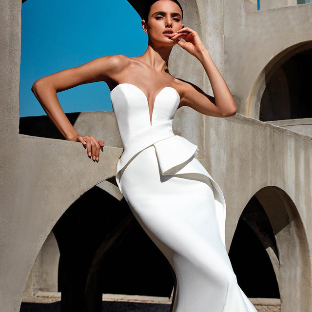 A sensual mermaid-style gown in eco-friendly crepe. Its the Lurene dress from the #WeDoEco Collection. Book your appointment at your nearest #Pronovias to try it on.
