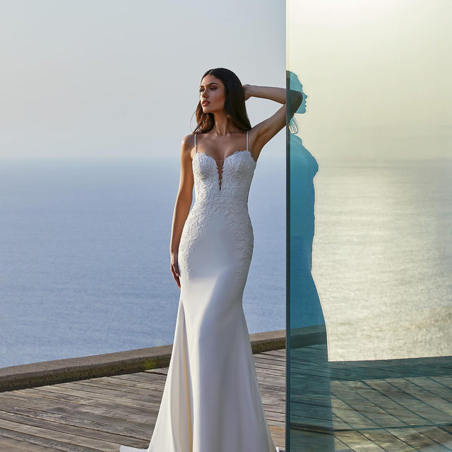 With or without statement sleeves?  A mermaid-cut gown with hand-threaded embroidery ripples over the hip and bodice. Try on the Clara dress at @raffaeleciucabridal Exclusive Event. Link in bio to sign up!
