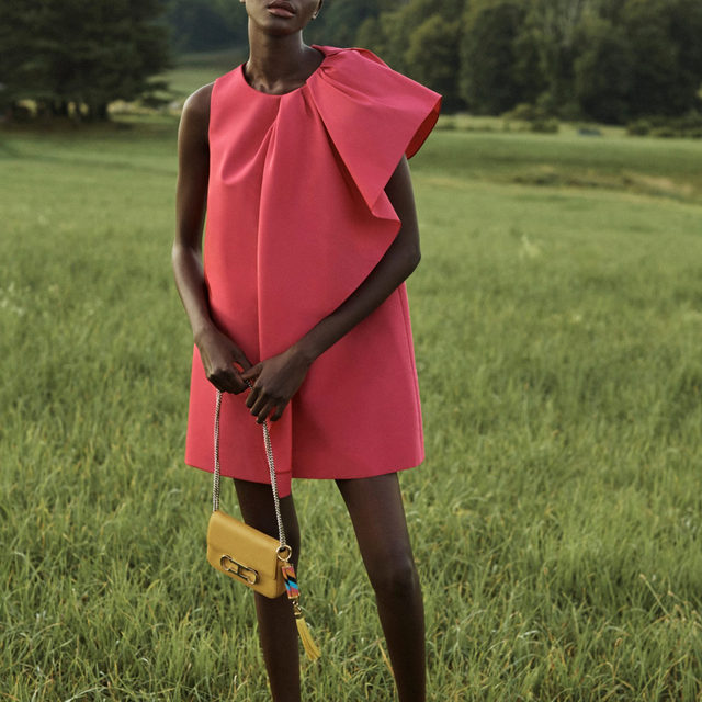 Effortlessly elegant, this Azalea pink mini dress is cut from silk faille and features a draped panel that sweeps gracefully across the front. Accessorize it with your favourite #CHInitialsInsignia bag. From our Resort 2021 lookbook, featuring @Achenrin captured by @Josholins.  Shop the collection now on www.carolinaherrera.com  #CHInsignia