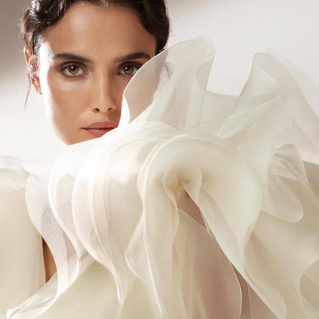 The statement bolero is one of our bridal stylists favourite #PronoviasTrends. Pair it with a sleek sheath gown in soft crepe as Rian from #AtelierPronovias. Link in bio to book your appointment and discover the New #PronoviasPremiere Collection at your nearest store.