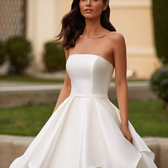 Grand gowns rule our dreams. Meet the ultimate  princess–style dress with sculptural ruffles. Dress: Florian. Try it on at your nearest #Pronovias.