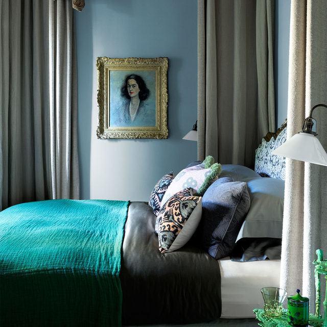 In our Jan/Feb2021 issue we explore a 16th-century Tuscan villa designed by @hubertzandberginteriors. The London-based designer's sophisticated sense of color is on view in a guest bedroom, where soft blue walls framed a bed canopy in a taupe @delecuona fabric. The portrait is from the homeowner's collection. Click the link in bio for the full tour. Written by Nancy Hass, produced by @cynthiaefrank, photography by @simonuptonphotos.
