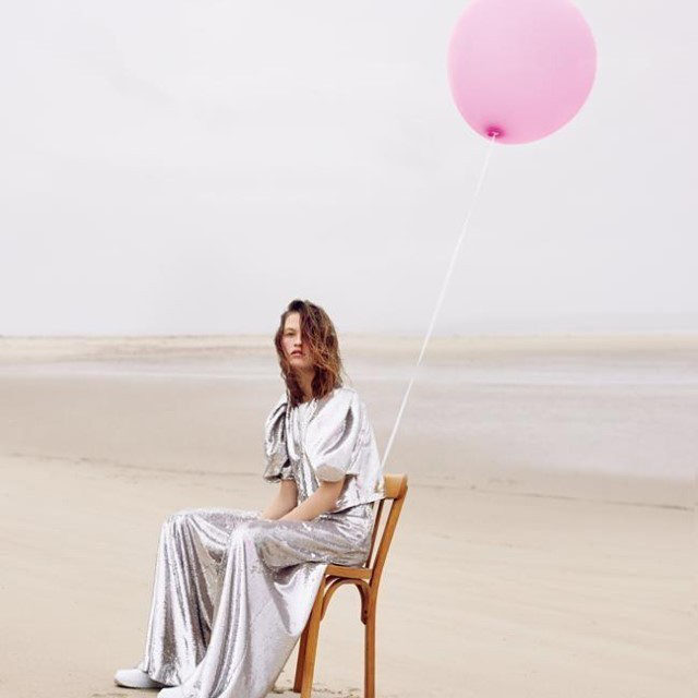 @vanya_es_mi_nombre is sitting pretty for @madamefigarofr wearing a dazzling puff sleeve top and wide leg pants from our Resort 2021 collection, covered all over in tiny silver sequins for a liquid metal effect.  Photographer: @jeanbaptistecourtier