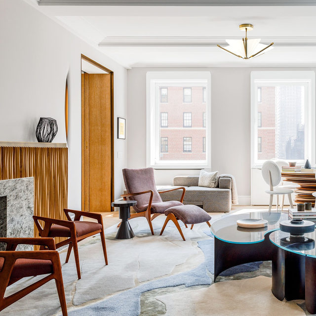 Stepping into a family's Manhattan living room designed by Michael K. Chen (@mkcarchitecture), you'll notice a blend of soft neutrals and brawny pieces in steel, wood, and marble. Chen, who's owned his firm for nine years, is known for fusing bold colors and bolder juxtapositions of materials, eras, and shapes. The @vladimirkagandesign chaise is in a fabric by @hollandandsherryinteriors. The custom cocktail table is by @kinandcompany, the games table and chairs are by @christopherkurtzstudio, and the pendant is by @bec_brittain. Click the link in bio for the full tour. Written by @langealexandra, photography by @maxb.photo.