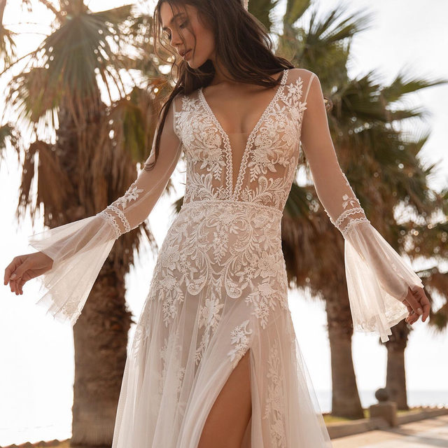 Ethereal elegance in lace and tulle with statement long bell sleeves. Its Tyson from the #HollywoodGlamour Collection. 📍Texas brides: try it on at @bridesgalleryofficial exclusive event from January 21st – January 31st. Limited places! Sign up on the link in our bio.