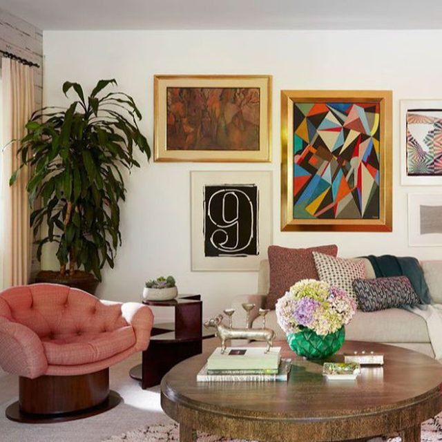 Boho meets Art Deco in this Santa Monica home, designed by @natashabaradaran for newlywed clients. Custom pieces feature subtle detailing and finishes—like the cerused finish on a cocktail table—for a feeling of laid-back luxury. In the family room, the sofa is from RH, Restoration Hardware, the cocktail table is custom, and the artwork is from @antoniosbellacasainc, @annehauckdesign, and Joseph Levine Art. Click the link in bio for the full tour. Written by @bebehoworth, photography by @rogerdaviesphotography.