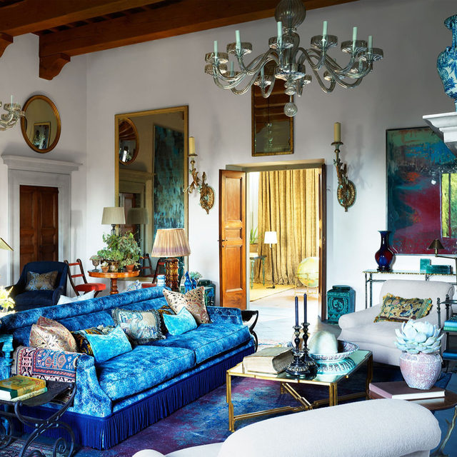 In the whimsical, colorful grand salon of a 16th-century Tuscan villa with interiors by Hubert Zandberg (@hubertzandberginteriors), the sofas in a Mulberry velvet and bronze side tables are all custom, and the white armchairs are covered in a @delecuona fabric. The chandeliers are @original_murano_glass. Click the link in bio for the full tour as seen in our Jan/Feb 2021 issue. Written by Nancy Hass, produced by @cynthiaefrank, photography by @simonuptonphotos.