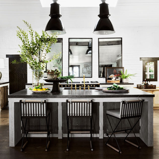 New York–based interior designer Steven Gambrel (@stevengambrel) was tapped by his good friends Alex and Sue Glasscock (owners of @theranchmalibu) to redesign their 150-acre property, originally owned by the movie star William Boyd, overlooking the Pacific Ocean in California's Santa Monica Mountains. In the kitchen, custom stools with cushions in a @dualoyleather pull up to an island topped with French limestone; the industrial pendants are vintage. Click the link in bio for the full tour as seen in our December 2020 issue. Written by @vwlawrence, photographs by @douglasfriedman.