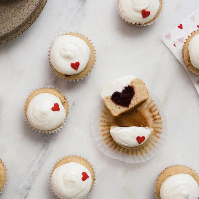 Find someone who looks at you the way we look at these red velvet heart surprise cupcakes by @acozykitchen 💓