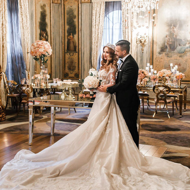 "A feature from @destinationido magazine! 🤗 In December 2020, the @bestvenuesnyc team asked us to collaborate in a luxury wedding shoot at @newyorkpalace! Nothing quite says ""Luxury NYC Wedding"" like a grand event in a real-life New York palace. The model wore a gorgeous @galialahav wedding dress from our Fifth Avenue salon, and paired it with an incredible crown and veil from @bridalstylesboutique! 👑 Click the link in our bio to see the full feature from @destinationido  📷: @artvestastudio 📔 planner: @bestvenuesnyc  🏰 @newyorkpalace  👰 dress: @galialahav from @bridalreflectionsny 👑 @bridalstylesboutique 💐 @evamadeleina  💌 invitation  designer: @cecinewyork  💃 specialty performers: @cirque_central  🤵 suit: @mrrobbiesuits  ✨ equipment rentals: @glampartyrentals  🖋️ calligraphy: @joannedaycalligraphy  🎂 @asimplecake_nyc  💄 makeup artist: @namani_mua 🎶 musicians: @acuteinflections"