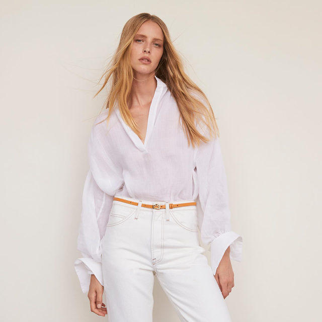 The little white shirt is back with a sultry deep v neck and sheer, gauzy fabrication.