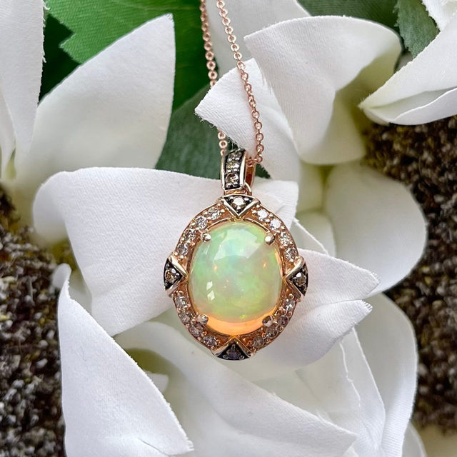 A budding beauty! The inner fire of an oval-shaped Opal glows brighter set amidst round-shape Chocolate Diamonds in this stunning pendant necklace.  Link in bio to shop! #LeVianColors