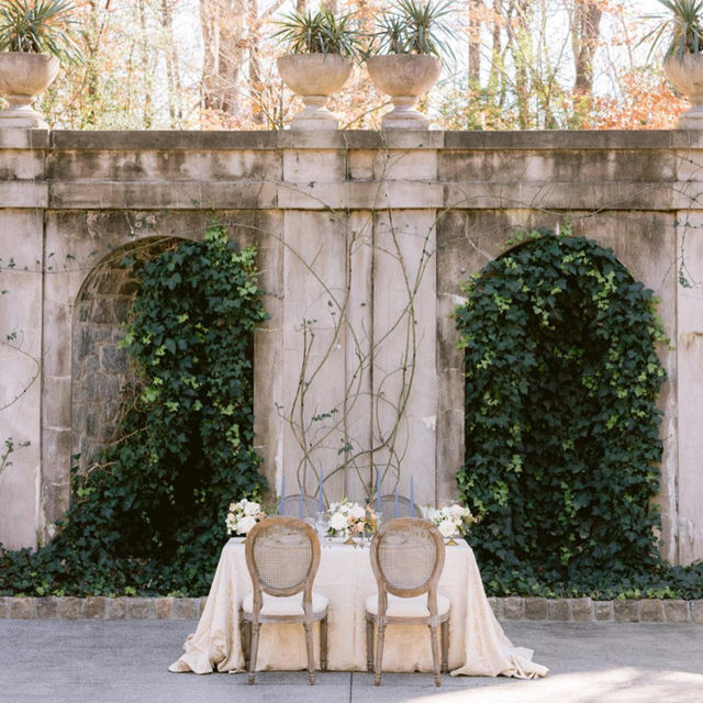 Natural stone, green ivy, and soft, romantic tones, this tablescape is the epitome of European elegance. ✨ Radiating beauty and sophistication, we are loving the old-world charm. Featuring our Antique Lucia Table Linen. Visit the link in our bio to see more of this stunning linen.  _________ Credits:  Planner: @juliepaisley Photographer: @rsvpeventdesigns Floral: @colonialhouseofflowers  Rentals: @whitegloverentals @collectionfurnishings Paper Goods: @thevintageinkwell Venue: @atlantahistorycenter