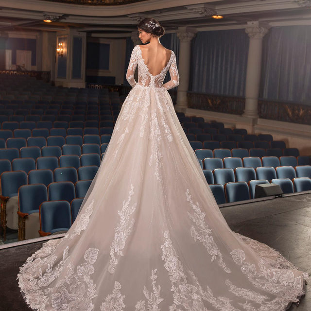 Fine tulle and exquisite lace. Meet the ultimate princess-style gown with fitted, three-quarter sleeves. Dress: Crawford. Book your appointment at your nearest #Pronovias Store or schedule a video virtual consultation with one of our expert stylists.