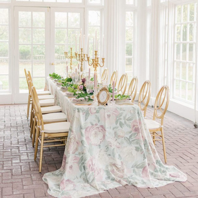 A picturesque fairytale esthetic to go with a stunningly breathtaking linen. Capturing the essence of spring, our Peonies table linen is a true showstopper. 🌸 A flower revered for its beauty and fragrant floral scent. The delicate shades of light green, soft pinks, and warm beiges blend effortlessly together creating a canvas of beautiful blooms fit for any event. Use the link in our bio to start planning your event with this gorgeous linen.  _________ Credits: Planner: @weddingcoordinationbyjeanette Photography: @kelseyalumbaugh Floral: @tsfloraldesign Rentals: @ultrapom Venue: @thehistoriclongview Host: @wed.kansascity